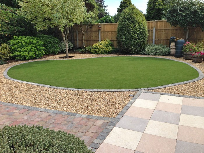 Landscaping in Barton on Sea. Artificial grass before being cut in for easy maintenance.