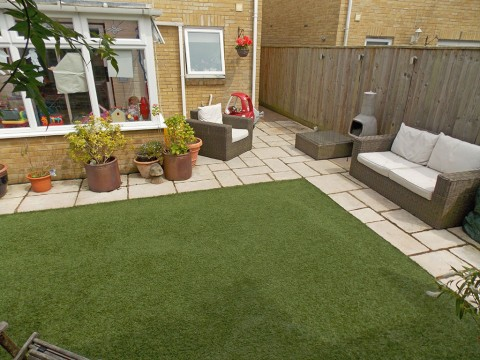 Landscaped garden with artificial grass in New Milton